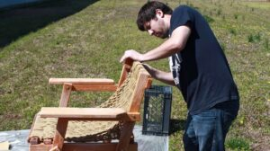 Sanding the Nags Head Hammocks outdoor chair