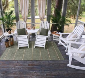 Outdoor living room with rocking chair, loungers, and outdoor rug