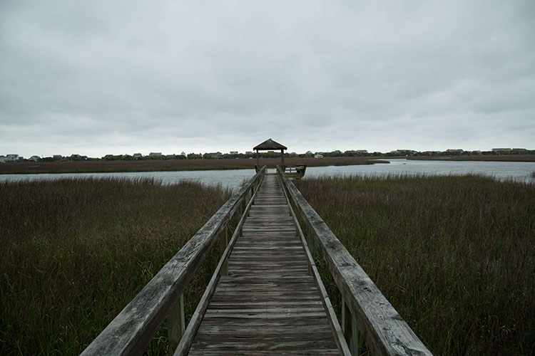 A pier off the South Carolina coast looking out into the Pawleys Island Salt Marsh