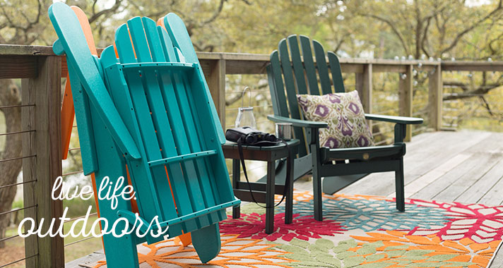 Outdoor patio with rug and two chairs
